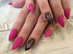 Matte fuchsia with hand painted black design almond shaped nails