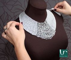 Crocheted silver collar with rich beadings