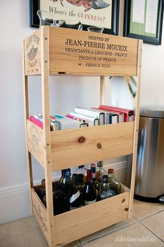 Aloha Home Solutions - DIY: Wine Crate Cookbook and Bar Cart. This is a super easy DIY wine crate! Build your own wine crate bar cart using wine crates. This one stores glassware, cookbooks and tasty adult beverages. Wood Crate Shelves, Wood Crates, Wood Boxes, Wine Box Shelves, Wooden Wine Boxes, Bar Shelves, Crate Bar, Wine Crate Decor, Rustic Wood Box