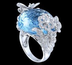 Blue Topaz & Diamond Ring                                  Blue Topaz ring with diamonds set in 18k white gold Farah Khan