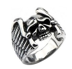 Statement making piece! This stainless steel skull ring embraced with wings ring will make an immediate impression. Because it is cast in stainless steel, the ring offers wicked detailing at every angle.