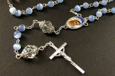 Baby Blue Rosary. Catholic Rosary with Cats Eye Blue Beads and Crystal Paters. Handmade Rosaries. by Gilliauna from Bits n Beads by Gilliauna. Find it now at http://ift.tt/1SJaHDM!