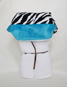 A personal favorite from my Etsy shop https://www.etsy.com/listing/199787687/zebra-print-and-turquoise-minky-hooded