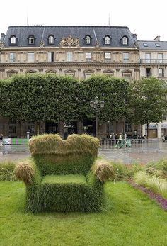 grass chair in front of the hotel de ville in paris france