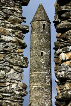 Round Tower, Glendalough, Ireland: Round Towers are medieval (9th to 12th c) stone towers found mainly in Ireland. They were likely used as bell towers or places of refuge often located near a church or monastery. Surviving towers are 18m (59 ft) to 40m (130 ft) in height. The masonry differs according to date. Earliest examples are uncut rubble, while later ones are neatly joined stone work. A single door is raised up 2 - 3m, accessible only by ladder. High windows are slits in stone -wikipedia