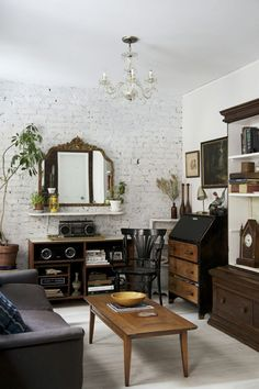 clean lines with antique touches. lots of wood, black, and gilded mirrors