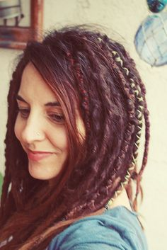 partial dread locks by Boho Photography // no dreads for me, but I like the idea of string-wrapped braids