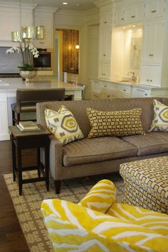 Traditional kitchen/family room w/ a punch of yellow