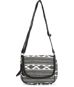 This black and white woven crossbody purse is made with a fully lined main compartment with a flap closure that doubles as a zip pocket for keeping all your essentials stored and secured.