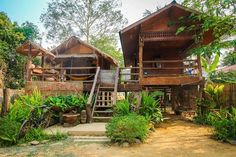Bamboo house design with natural nuances. Staying in a bamboo house will bring you to the atmosphere of living in nature. Bamboo House Bali, Bamboo House Design, Hut House, Off Grid House, Timber Architecture, Jungle House, House On Stilts, Beach Bungalows, Village Houses