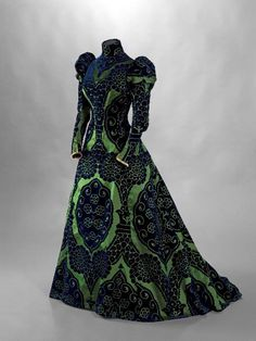 an absolutely stunning Victorian green- blue brocade tea gown designed by the genious mr. Worth. 1895.