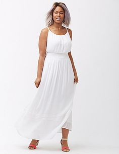 A maxi dress that makes the head-to-toe white trend totally effortless. Also effortless: that waist-defining smocking and crochet detail. Adjustable spaghetti straps. Pull-on style. Lined.  lanebryant.com
