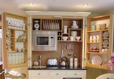 6 modelos de cocinas escondidas en armarios que te van a encantar