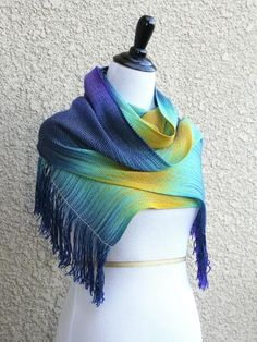 """Hand woven scarf in blue and brown colors. Perfect gift idea! This woven scarf is very soft and drapes perfectly! Measures: L: 78"""" with 6"""" fringe on both ends W: 11"""" Care instructions: This scarf made"""