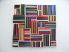 Very simple idea, Coloured pencils glued to a board in a pattern 60 x 60 cm.