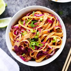These 20-Minute Sesame Chicken Noodle Bowls with Thai-style creamy peanut sauce and crunchy red cabbage make a perfect quick and easy weeknight dinner.
