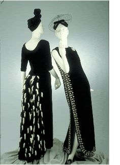 Evening Dresses, Cristóbal Balenciaga, 1966-1968.    Left: Dress of black rayon velvet with a bustle trimmed with ermine tails.  Right: Dress of black velvet with pearls, rhinestones, and beads.  Right: Inspired by a priest's chasuble.
