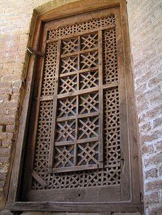 Old wooden and glass door in the khan (caravanserai) of Bazaar-e Vakil, Shiraz, Iran.