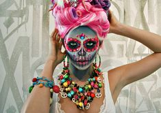 "Makeup Artist and Model Lindsay Hancock brings her magical sugar skull look to life with these new photos, just in time for Halloween on October 31st and The Mexican Day Of The Dead Holiday, known as ""Dia De Los Muertos"" which falls on November 1st & 2nd. Bursting with color, Lindsay takes a stroll through the Retna Exhibit at the Michael Kohn Gallery. Lindsay even filmed a cool makeup tutorial demonstrating how to create the Sugarskull look. Photography by Chaz Dinero"