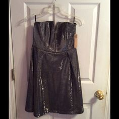 """Silver and black strapless semi-formal dress Silver and black semi-formal strapless dress, 30"""" from top to hem, 16"""" from armpit to armpit, says a large but it is really a small or extra small, very pretty flare skirt, new with tags. Everly Dresses Strapless"""