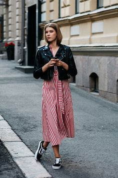 Leather jacket and striped dress - The Best Of Helsinki Street Style