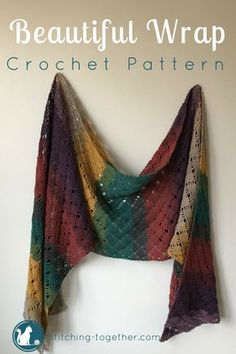 A free crochet pattern to make this beautiful shawl. The lacy texture makes it perfect for a night out on a cool summer evening. Made in a large rectangle, it's easy to wrap up in this crochet shawl. The striping pattern happens naturally using Lion Brand's Mandala yarn. #crochet #crochetshawl #crochetwrap #crochetscarf #mandalayarn #lionbrandyarn #freepattern #crochetpattern #pattern #easycrochet #stitchingtog