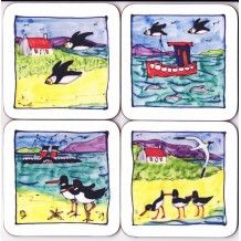 Placemats - this charming set features a slightly different design all of which include the birds and boats found along the Scottish coastline, instantly brings fun and color to any dining room.  Coasters to match.  www.scottishcreations.com