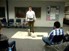 Brick breaking demonstration by Indiana author Mike Mullin at the DeMotte Library, 2011