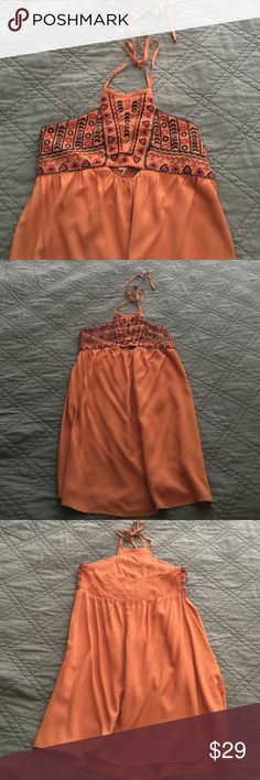 Local Boutique Aztec Dress Burnt Orange Never been worn. Purchased from a Local Boutique. Beautiful casual dress but way to short for me! Wish I could wear it! Definitely a petite dress. Boutique Dresses Backless