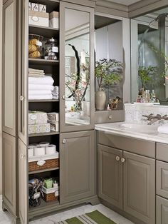 Hold everyday bath items, towels, and sheets in a built-in armoire that boasts floor-to-ceiling shelves. Keep everything neat and tidy within the mirrored cabinet by storing items in labeled boxes and bins - Bathroom Flooring Bathroom Closet, Bathroom Doors, Closet Bedroom, Bedroom Storage, Bathroom Flooring, Master Bathroom, Organized Bathroom, Bathroom Organization, Bathroom Shelves