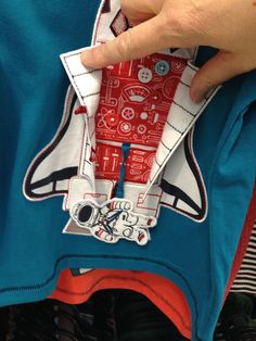 #ThinkDo - How can you make your ideas for the design question stand out from the crowd? What about some 3D appliqué? Take a look at this t.shirt. The rocket doors open to reveal an astronaut that either sits inside the rocket or who can float around in space.