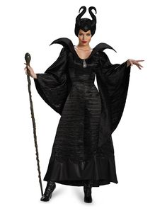 Maleficent Christening Gown Adult Womens Costume at Spirit Halloween - How evil can you be when you decide to wear the officially licensed Maleficent Christening Gown Adult Women's Costume? This classic Disney character outfit features a hauntingly stunning black gown with a raven broach, complete with a masterful character headpiece. Become this villain for $49.99