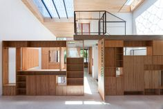 """Inside """"Casa Scout"""" by BAAG (Buenos Aires Arquitectura Grupal), the presence of timber-cabinets-as-walls gives a ludic lego-like character to the interior, appropriate to the playfulness of the scouts' activities."""