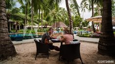 Stock Footage of Couple having summer lunch, drinking cocktails at luxurious resort under palm trees next to outdoor swimming pool, tropical island. Explore similar videos at Adobe Stock Outdoor Swimming Pool, Swimming Pools, Cocktail Drinks, Cocktails, Stock Video, High Quality Images, Palm Trees, Stock Footage, Adobe
