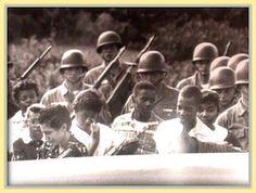 The Little Rock Nine get an armed escort to school.  Black History X: Little Rock 'Nine' - Segregated Schools