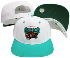 Vancouver Grizzlies White/Teal Two Tone Snapback Adjustable Plastic Snap Back Hat / Cap by adidas. $19.95. Embroidered Logos. One Size Fits All. Adjustable plastic snapback cap. Officially Licensed.. Make a fashion statement while wearing this retro snapback cap.