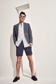 Bringing smart style to the forefront, Mikkel Jensen dons a sport coat with a striped shirt and shorts.