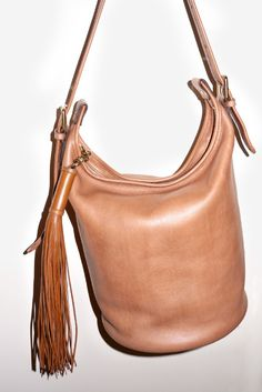 I love the old coach bucket bag...leave it to Chloe to bring it back and add a tassel....gimme