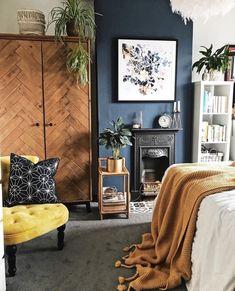 Dark chimney breast, herringbone style wardrobe, yellow and mustard tones and plenty of plants in the bedroom Dark Painted Walls, Dark Blue Walls, Teal Walls, Dark Blue Lounge, Blue Bedroom Decor, Bedroom Decor For Couples, Bedroom Inspo, Indigo Bedroom, Bedroom Ideas