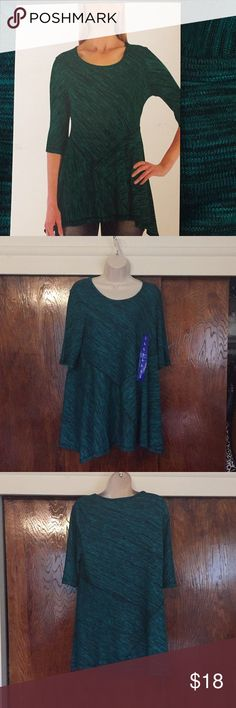 A-Line Green Black Tunic Top Features: * Top stitch seams   * Flare  hem * Scoop neck * 3/4 Length sleeves  * Stretch Rayon polyester fabric Could be used as a maternity top Fever Tops Tunics