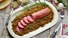 A repast of cotechino and lentils is an Italian New Year tradition Culture Of Italy, New Years Traditions, Macaroons, Lentils, Sushi, Seafood, Sausage, Fries, Curry