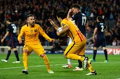 Luis Suarez of Barcelona celebrates with Jordi Alba as he scores their first and equalising goal during the UEFA Champions League quarter final first leg match between FC Barcelona and Club Atletico de Madrid at Camp Nou on April 5, 2016 in Barcelona