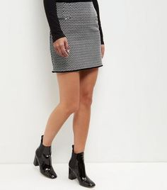 "For an elegant look this season try this jacquard mini skirt. Pair with a turtle neck top and high shine ankle boots to complement.- Soft cotton blend- All over diamond print- Jacquard texture- Double zip pocket detail- Zip back fastening- Frayed hem- Casual fit that is true to size- Erika is 5'9""/175cm and wears UK 10/EU 38/US 6"