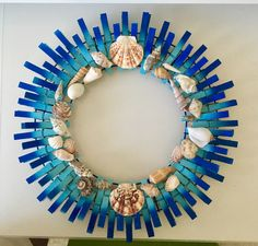 My first with a wreath made with clothes pins. Did spray paint ombré look for . , My first with a wreath made with clothes pins. Did spray paint ombré look for beach theme with shells. I do recommend spraying the wreath holder a col. Seashell Art, Seashell Crafts, Beach Crafts, Summer Crafts, Crafts To Make, Home Crafts, Diy Crafts, Party Crafts, Seashell Wreath