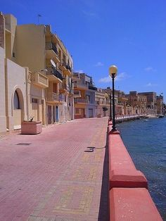 Promenade at Birżebbuġa. This little seaside village was once a great location for swimming. The construction of Malta's Freeport in the 1980s and the huge development of Buġibba -overrun with tacky 'British' bars and high rise slums has spoiled the location. The locals do swim there still but as a beach- there are plenty of other spots and our visit in 2016 has sealed it as a no go area to stay. Very very sad