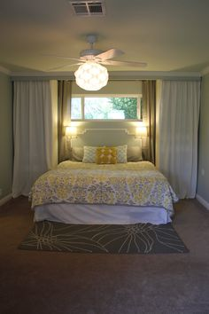 headboard idea? Basement bedroom? I like the grays and yellows and the bed under the window