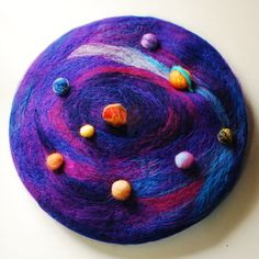 Eight planets move around the sun french beret needle by MoonBeret