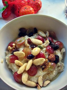 Healthy Breakfast: delicious oatmeal with almonds, raisins, grapes and walnuts