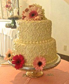 A pretty fondant vintage cake with fresh Gerbera daisies. Love!