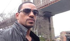 """Laz Alonso takes a break for a photo while taping his new series, """"The Mysteries of Laura."""""""